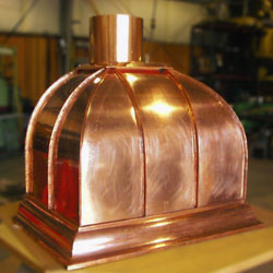 Custom-designed and fabricated copper residential kitchen hood.