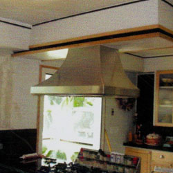 Custom-designed and fabricated stainless steel residential kitchen hood.