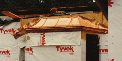 Custom-designed copper mansard roofs, hand-fabricated.